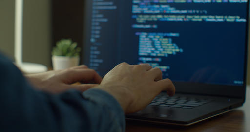 Closeup coding on screen, Man hands coding html and programming on screen laptop Live Action