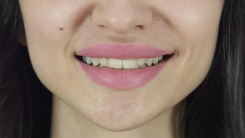 Smiling Lips of Beautiful Woman Close Up, White Background Footage