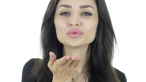Flying Kiss Lips by Young Beautiful Woman, White Background Footage