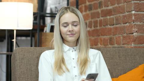 Female listening Music with headphones, Smartphone Footage
