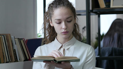 Woman Reading Book in Office Footage