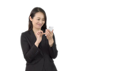 Young Japanese business woman using iphone 3 Live Action