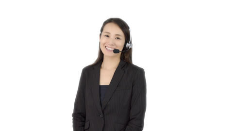 Japanese business woman chatting with headset Footage
