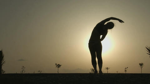 Female silhouette doing yoga exercises for harmony of healthy body and mind Footage