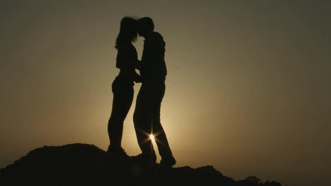 Silhouettes of newlyweds couple kissing passionately. Romantic love story Footage