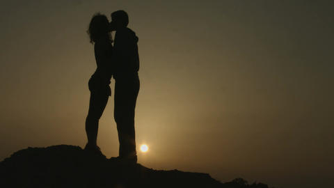 Couple kissing tenderly at romantic date outdoors. Man and woman in love hugging Footage
