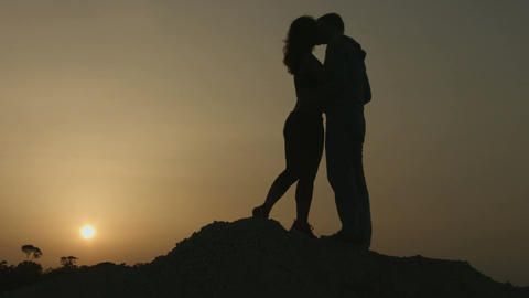 Boyfriend and girlfriend kissing, looking at sunset. Happy together forever Footage