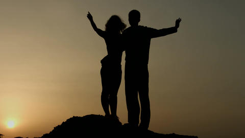 Silhouette of happy couple enjoying sunset together, looking in future with hope Footage