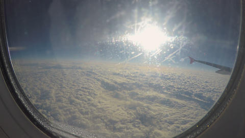 POV of passenger looking through porthole glass at cloudscape. Travel by plane Footage