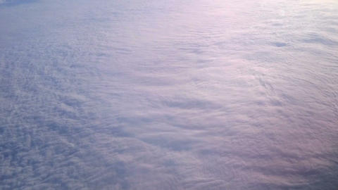 Aerial shot of beautiful clouds below plane. View of hurricane from open space Footage