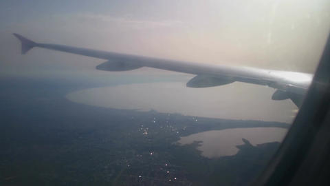 Military rescue aircraft over dangerous battle zone. Seascape view from plane Footage