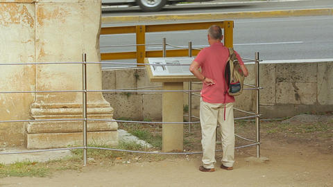 Man checking reference information at exhibition, sightseeing tour around city Footage