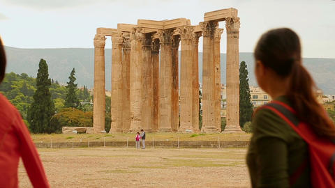 Tourists posing near tall Corinthian columns of the Temple of Olympian Zeus Footage
