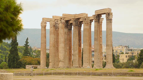 Man walking near remains of Olympian Zeus Temple in Athens, tourist attraction Live Action