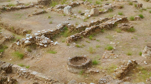 Tourists viewing historic site, ancient building remains excavated by scientists Footage