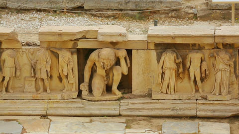 Remains of marble relief at ancient theater in Athens, place of tourist interest Footage