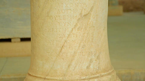 Greek inscription on ancient marble column, exhibit item at historical museum Footage