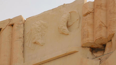 Classical Greek architecture detail, remains of stone relief on top of building Live Action