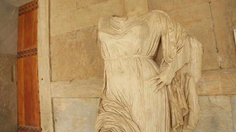 Headless female marble stone statue of goddess at museum, cultural heritage Footage