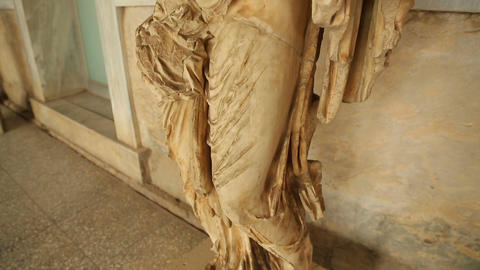 Remains of ancient marble statue at archaeological museum, cultural heritage Footage