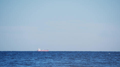 Timelapse of container ship sailing along the horizon. Huge container ship Live Action