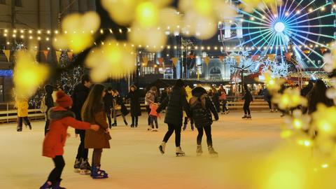 Ice skating during Christmas holidays. People skating on an outdoor skating rink Live Action
