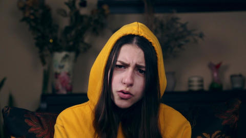 Human expressions and emotions. Portrait of young furious girl with angry face Live Action