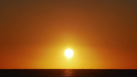 Sunrise over the sea. Amazing red sunrise on the beach in Egypt. Orange color of Live Action