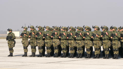 Platoon of Soldiers with Combat Military Equipment in Green Mimetic Camouflage Live Action
