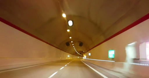 driving through tunnel gallery and orange light tint, abstract with motion blur high speed Live Action