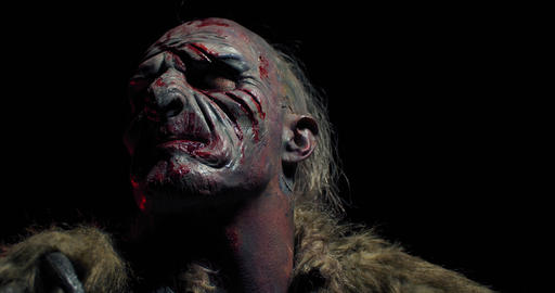 Portrait of an orc with cuts and blood on his face, scary fantasy movie, 4k Live Action