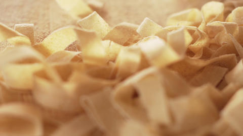 Macro close up tracking view of fresh home made tagliatelle pasta just rolled and cut with bokeh Live Action