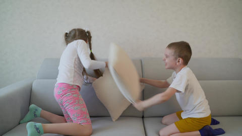 Kids fight with pillows. kids fighting pillows in the bedroom Live Action