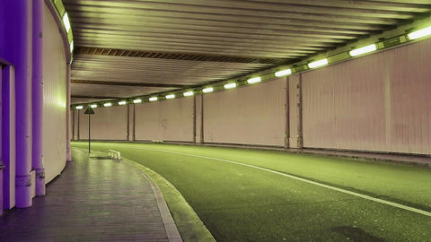Monte-Carlo, Monaco, tunnel in the night, colourful illuminated, lonely car at Live Action