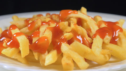French fries with spicy ketchup Live Action