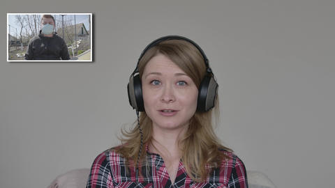 Young blond woman with grey eyes talking in video chat with man in face mask Live Action