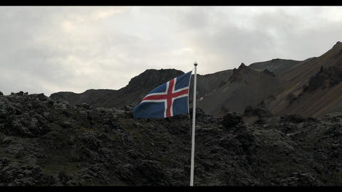the Icelandic flag flies in the beautiful landscape of Landmannalaugar Live Action