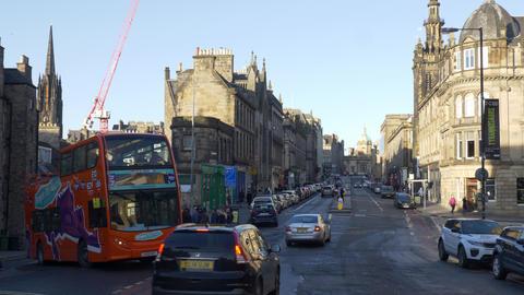 Sightseeing Bus in the historic district of Edinburgh - EDINBURGH, SCOTLAND - Live Action