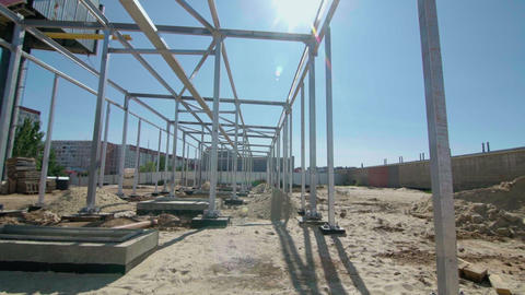 Building workers are constructing a metal framework. New constructions site Live Action