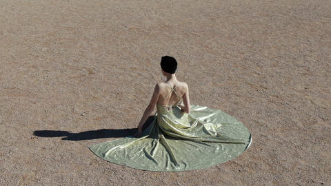 A young woman in an evening dress sits on a sand Art deco woman Ar nuvo fashon GIF