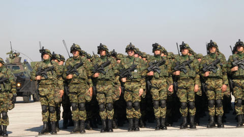 Portrait of Soldiers with Green Mimetic Uniform and Combat Military Equipment Live Action