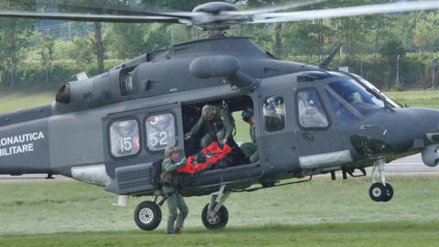 Rescuers jump out of a helicopter AgustaWestland AW139 Live Action