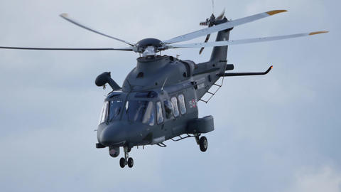 Helicopter in hovering salutes by bowing. It is an Agusta Westland AW139 Live Action