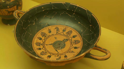 Black clay kylix with warrior, ancient Greek pottery art, Agora museum exhibit Footage