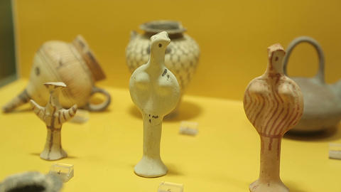 Tiny ceramic figurines from ancient Greek children's tombs, Agora Museum display Footage