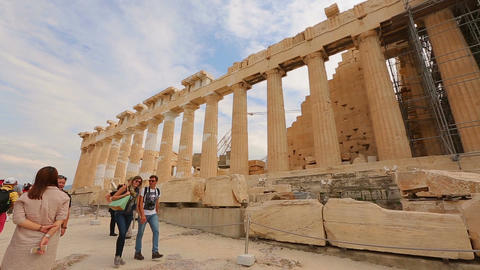 Happy young couple enjoying honeymoon trip to Greece, viewing ancient Parthenon Live Action