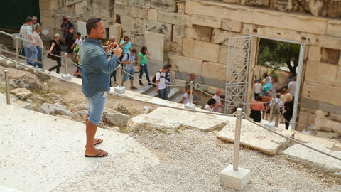 Young man taking photo of historical site on smartphone, people travel with kids Live Action
