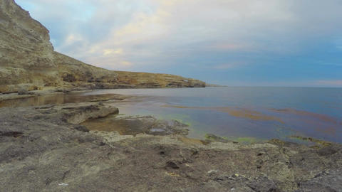 Amazing day to night timelapse of beautiful seascape, stony shore, clear water Footage