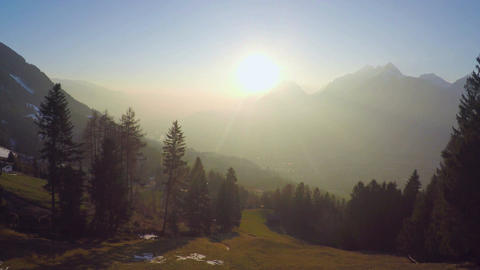 Magic hour sunrise in wonderland, mountain silhouettes in golden sunrays, beauty Footage