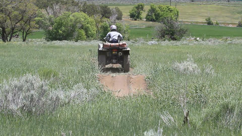 ATV boy rides trail P HD 0851 Footage